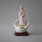 Imagem de Santa Luzia com flores em porcelana com 12,5 cm