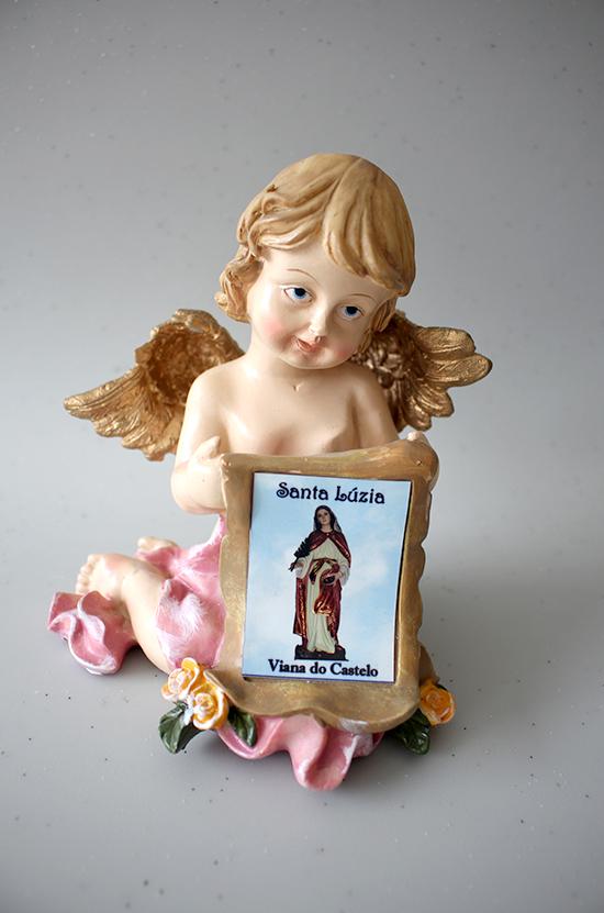 Anjo com foto de Santa Luzia